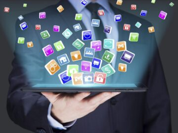 A person holding tablets