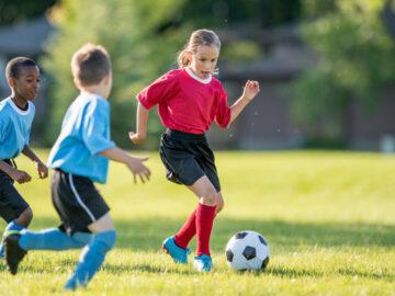 kids playing football playground